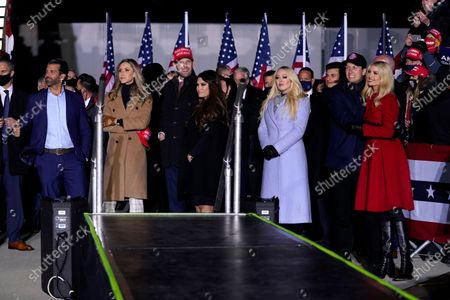 From Left, Donald Trump Jr., Lara and Eric Trump, Kimberly Guilfoyle, Tiffany Trump, Jared Kushner and Ivanka Trump listen as President Donald Trump speaks during a campaign rally at Kenosha Regional Airport, in Kenosha, Wis