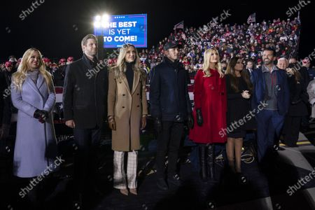 Tiffany Trump, Eric Trump and his wife Lara Trump, Ivanka Trump and her husband Jared Kushner, and Donald Trump Jr., and his girlfriend Kimberly Guilfoyle, listen as President Donald Trump speaks at campaign rally at Gerald R. Ford International Airport, in Grand Rapids, Mich