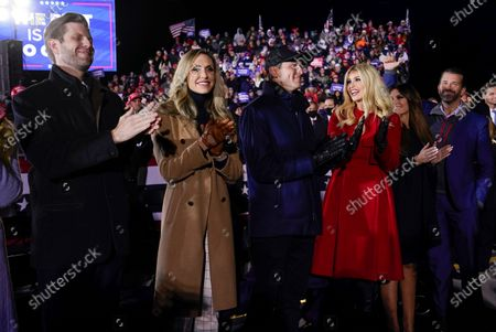 Eric Trump and his wife Lara Trump, Ivanka Trump and her husband Jared Kushner, and Donald Trump Jr., and his girlfriend Kimberly Guilfoyle, listen as President Donald Trump speaks at a campaign rally at Gerald R. Ford International Airport, early, in Grand Rapids, Mich