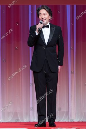 The 33rd Tokyo International Film Festival ambassador Koji Yakusho delivers a speech during the opening ceremony of the festival