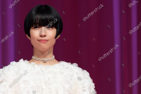Cast member Yui Sakuma from the movie 'Eternally Younger Than Those Idiots' enters between plastic walls on the stage, installed in order to prevent infections following the coronavirus disease (COVID-19) outbreak, as they attend the opening ceremony of the 33rd Tokyo International Film Festival