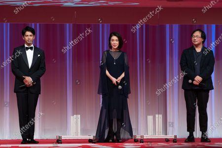 Japanese film director Koji Fukada, right, actor Win Morisaki and actress Mariko Tsutsui during the opening ceremony of the Tokyo International Film Festival in Tokyo, Saturday, Oct. 31, 2020.