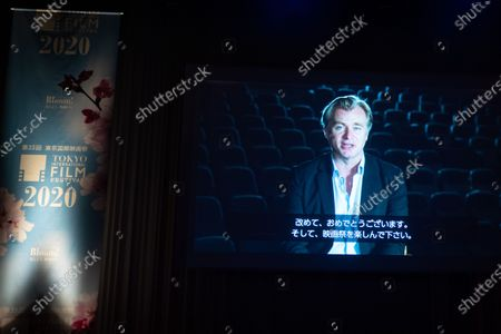 A video message by director Christopher Nolan is screened during the opening ceremony at 33rd Tokyo International Film Festival