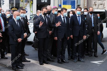(From Left) Eric Ciotti, French Interior Minister Gerald Darmanin, French Justice Minister Eric Dupond-Moretti, French President Emmanuel Macron and Nice Mayor Christian Estrosi (3rd-L) visit the scene of a knife attack at the Basilica of Notre-Dame de Nice in Nice on October 29, 2020. France's national anti-terror prosecutors said Thursday they have opened a murder inquiry after a man killed three people at a basilica in central Nice and wounded several others.