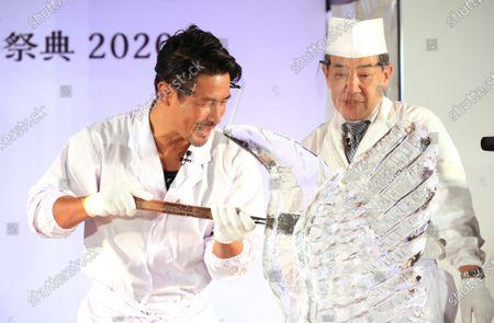 Editorial photo of Fomer K-1 champion Masato makes an ice sculpture at a craftwork exhibition, Tokyo, Japan - 03 Nov 2020