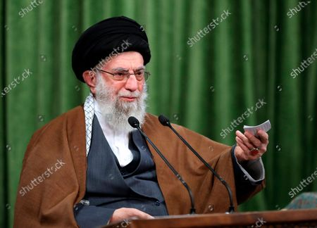 In this picture released by an official website of the office of the Iranian supreme leader, Supreme Leader Ayatollah Ali Khamenei addresses the nation in a televised speech marking the birthday of Islam's Prophet Muhammad, in Tehran, Iran, . Iran's supreme leader mocked America's presidential election in a televised address. In his remarks Tuesday, Khamenei quoted President Donald Trump's own baseless claims about voter fraud to criticize the vote as Tehran marked the 1979 U.S. Embassy hostage crisis