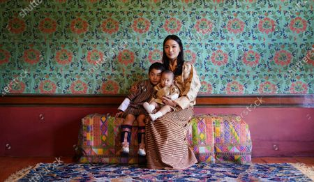 Stock Image of Her Majesty Queen Jetsun Pema Wangchuck, His Royal Highness Gyalsey Jigme Namgyel (Born 5 Feb 2016) and His Royal Highness the Gyalsey (born 19 March 2020) taken at Dechencholing Palace, Thimphu