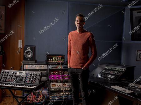 Stock Photo of Gael Faye in the recording studio
