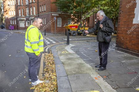 Dan Cruickshank stages a historians v builders heritage protest at Arnold Circus, London, E2 where local council are rushing through street closure measures with consultation.
