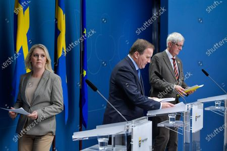Swedish Minister for Health and Social Affairs Lena Hallengren (L-R), Prime Minister Stefan Lofven and the Director General of the Public Health Authority of Sweden Johan Carlson arrive for a joint news conference on the coronavirus (Covid-19) pandemic situation at the government headquarters in Stockholm, Sweden, 03 November 2020.
