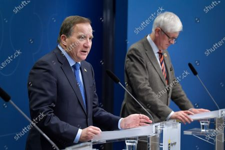 Prime Minister Stefan Lofven and the Director General of the Public Health Authority of Sweden Johan Carlson attend a joint news conference on the coronavirus (Covid-19) pandemic situation at the government headquarters in Stockholm