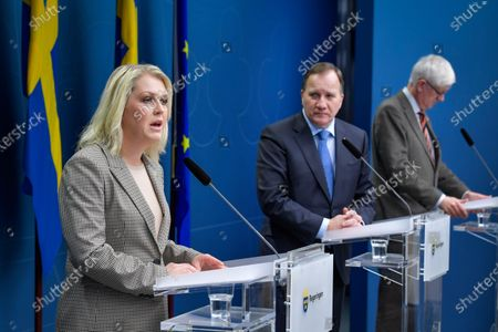 Swedish Minister for Health and Social Affairs Lena Hallengren (L-R), Prime Minister Stefan Lofven and the Director General of the Public Health Authority of Sweden Johan Carlson attend a joint news conference on the coronavirus (Covid-19) pandemic situation at the government headquarters in Stockholm