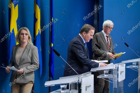 Swedish Minister for Health and Social Affairs Lena Hallengren (L-R), Prime Minister Stefan Lofven and the Director General of the Public Health Authority of Sweden Johan Carlson arrive for a joint news conference on the coronavirus (Covid-19) pandemic situation at the government headquarters in Stockholm