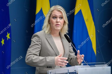 Swedish Minister for Health and Social Affairs Lena Hallengren speaks during a joint news conference with Prime Minister Stefan Lofven and the Director General of the Public Health Authority of Sweden Johan Carlson on the coronavirus (Covid-19) pandemic situation at the government headquarters in Stockholm