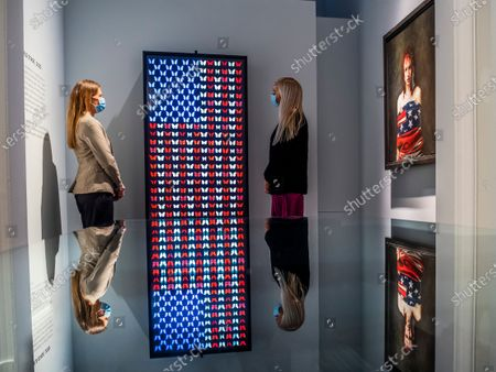 On the day of the US Election a new work animating the US flag by digital artist Dominic Harris is in the gallery windows as well as in the gallery itself - alongside portraits by Mitch Griffiths. It is part of US NOW at the Halcyon Gallery looks at how artists appropriate national and political figures, imagery and iconography to question identity on both an individual and community level
