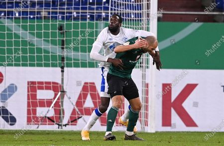 Salif Sane (L) of Schalke fouls Adam Jabiri of Schweinfurt during the German DFB Cup first round soccer match between 1. FC Schweinfurt 05 and FC Schalke 04 at Veltins Arena in Gelsenkirchen, Germany, 03 November 2020.