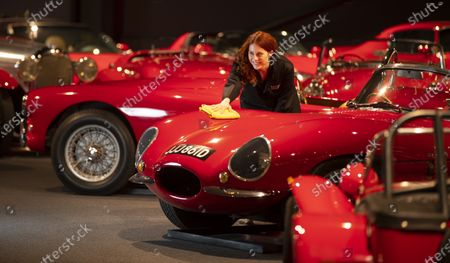 Stock Photo of Katie Stanley gives cars in the red room a final polish.   One of Britain's most prestigious motor museums has reopened after being closed for seven months due to the coronavirus pandemic.  The Haynes International Motor Museum at Sparkford, Somerset, has altered its layout to meet social distancing guidelines.  The historic vehicles on display include a Williams Formula 1 car driven by Nigel Mansell which was wheeled into position.  In total, there are over 400 cars and motorcycles, as well as other automobiles, at the museum which was established in 1985 by John Haynes, the creator of the Haynes Manual.  Some of them are on display at the museum's Red Room, where iconic red motors include a 1933 Morgan Supersport and a 1959 Austin Healey Sprite Mk1.