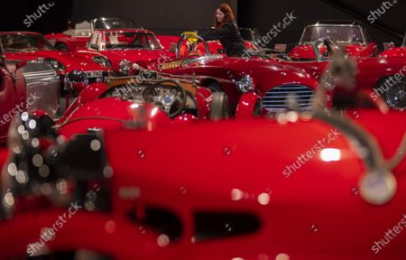 Stock Image of Katie Stanley gives cars in the red room a final polish.   One of Britain's most prestigious motor museums has reopened after being closed for seven months due to the coronavirus pandemic.  The Haynes International Motor Museum at Sparkford, Somerset, has altered its layout to meet social distancing guidelines.  The historic vehicles on display include a Williams Formula 1 car driven by Nigel Mansell which was wheeled into position.  In total, there are over 400 cars and motorcycles, as well as other automobiles, at the museum which was established in 1985 by John Haynes, the creator of the Haynes Manual.  Some of them are on display at the museum's Red Room, where iconic red motors include a 1933 Morgan Supersport and a 1959 Austin Healey Sprite Mk1.