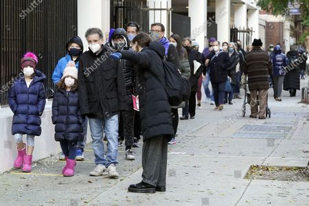 Voters line up outside Frank McCourt High School on Election Day, on New York's Upper West Side