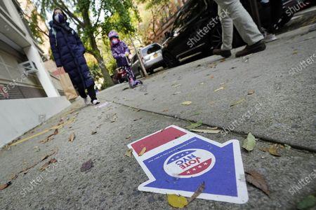 Sidewalk sticker directs voters at Frank McCourt High School, on New York's Upper West Side