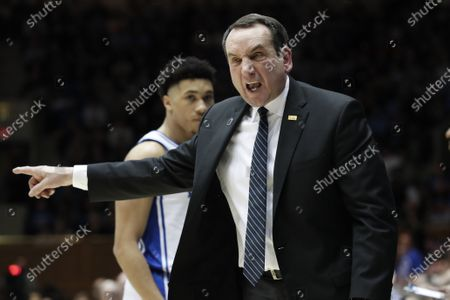 Duke head coach Mike Krzyzewski reacts to an official during the second half of an NCAA college basketball game against North Carolina in Durham, N.C. The NCAA's announcement college basketball start date led to huge scramble as schools tried to fill out schedules altered by the coronavirus pandemic