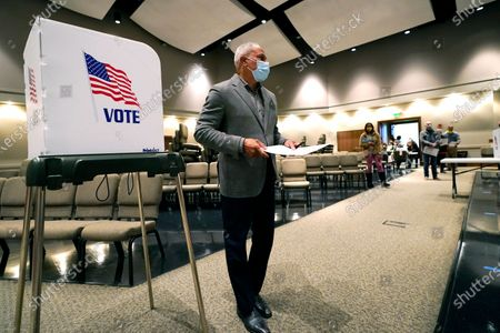 Democratic senatorial candidate Mike Espy walks away from a voting booth after filling out the ballot in Ridgeland, Miss., . Espy faces incumbent Republican U.S. Sen. Cindy Hyde-Smith and Libertarian candidate Jimmy Edwards in the general election