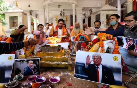 Stock Photo of Activists of Hindu Sena perform rituals and offer prayers for the victory of President Donald Trump in the US presidential elections. Activists of Hindu Sena, a right-wing group hold a prayer ceremony for President Donald Trump's victory in the US presidential elections in New Delhi.