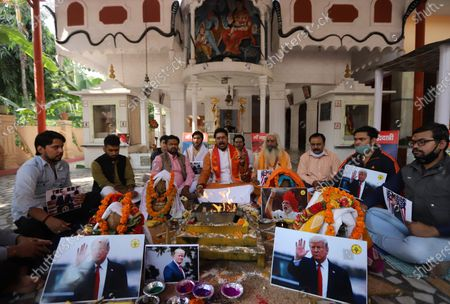 Stock Picture of Activists of Hindu Sena perform rituals and offer prayers for the victory of President Donald Trump in the US presidential elections. Activists of Hindu Sena, a right-wing group hold a prayer ceremony for President Donald Trump's victory in the US presidential elections in New Delhi.