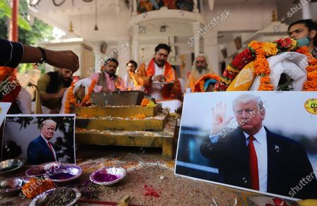 Activists of Hindu Sena perform rituals and offer prayers for the victory of President Donald Trump in the US presidential elections. Activists of Hindu Sena, a right-wing group hold a prayer ceremony for President Donald Trump's victory in the US presidential elections in New Delhi.