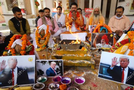 Stock Image of Activists of Hindu Sena perform rituals and offer prayers for the victory of President Donald Trump in the US presidential elections. Activists of Hindu Sena, a right-wing group hold a prayer ceremony for President Donald Trump's victory in the US presidential elections in New Delhi.