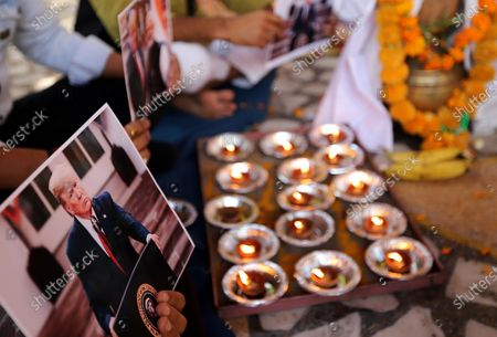 A portrait of US President Donald Trump is seen during a prayer ceremony in New Delhi. Activists of Hindu Sena, a right-wing group hold a prayer ceremony for President Donald Trump's victory in the US presidential elections in New Delhi.