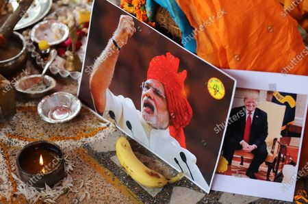 A portrait of US President Donald Trump and India Prime Minister Narendra Modi is seen during a prayer ceremony. Activists of Hindu Sena, a right-wing group hold a prayer ceremony for President Donald Trump's victory in the US presidential elections in New Delhi.