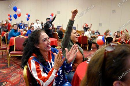 Loretta Oakes, left, and Dina Lynn of Las Vegas, cheer during a Republican watch party at the South Point Hotel & Casino in Las Vegas, Nevada, USA, 03 November 2020. Americans vote on Election Day to choose between re-electing Donald J. Trump or electing Joe Biden as the 46th President of the United States to serve from 2021 through 2024.