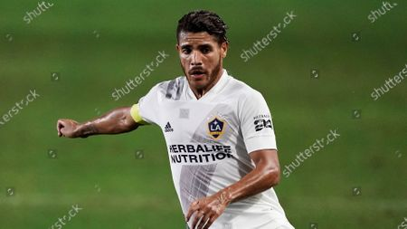 Los Angeles Galaxy's Jonathan dos Santos moves the ball during the second half of an MLS soccer match against the Real Salt Lake, in Carson, Calif