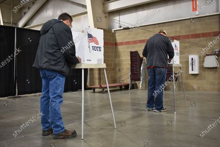 Voters are seen filling out their ballots on at the MetraPark events center in Billings, Montana. Record numbers of voters have cast a ballot this year in the state