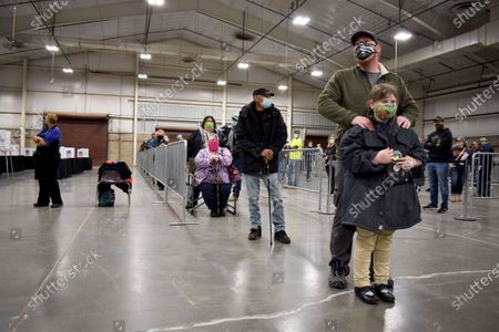 Voters wait in line on at the MetraPark events center in Billings, Mont. Montana voters were picking candidates for president, Senate, House, governor and other races