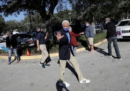 U.S. Representative Charlie Crist (C)  from Florida's 13th congressional waves to supporters at the St. Petersburg Coliseum, in St. Petersburg, Florida, USA, 03 November 2020. Americans vote on Election Day to choose between re-electing Donald J. Trump or electing Joe Biden as the 46th President of the United States to serve from 2021 through 2024.