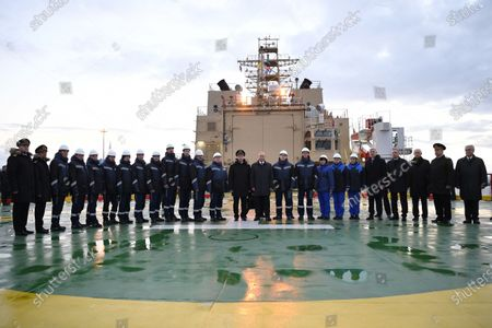 Russian President Vladimir Putin (C) pose for a group photo with crew members and officials aboard the newly built diesel-electric powered 'Viktor Chernomyrdin' icebreaker (Project 22600 ) in the Marine Facade passenger port in St. Petersburg, Russia, 03 November 2020. The 'Viktor Chernomyrdin' ice breaking vessel is said to be able to move in a continuous ice field up to two meters thickness.