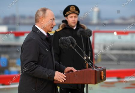 Russian President Vladimir Putin (L) speaks during a flag raising ceremony aboard the newly built diesel-electric powered 'Viktor Chernomyrdin' icebreaker (Project 22600 ) in the Marine Facade passenger port in St. Petersburg, Russia, 03 November 2020. The 'Viktor Chernomyrdin' ice breaking vessel is said to be able to move in a continuous ice field up to two meters thickness.