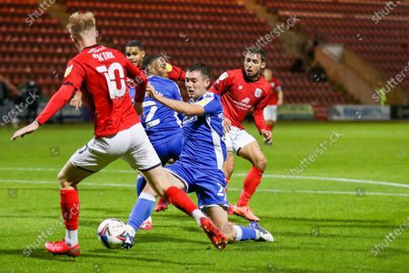 Gillingham FC defender Ryan Jackson (2) tackles Crewe Alexandra midfielder Charlie Kirk (10) during the EFL Sky Bet League 1 match between Crewe Alexandra and Gillingham at Alexandra Stadium, Crewe