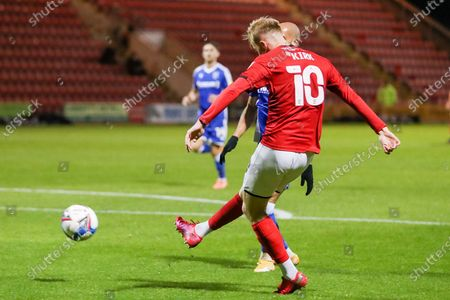 Crewe Alexandra midfielder Charlie Kirk (10) has a shot during the EFL Sky Bet League 1 match between Crewe Alexandra and Gillingham at Alexandra Stadium, Crewe