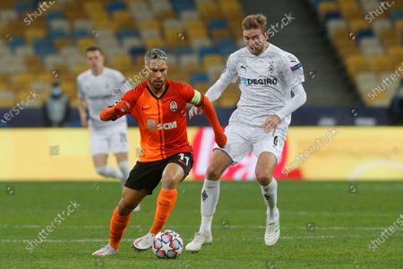 Shakhtar's Marlos, left, is challenged by Moenchengladbach's Christoph Kramer during the Champions League, Group B, soccer match between Shakhtar Donetsk and Borussia Moenchengladbach at the Olimpiyskiy Stadium in Kyiv, Ukraine