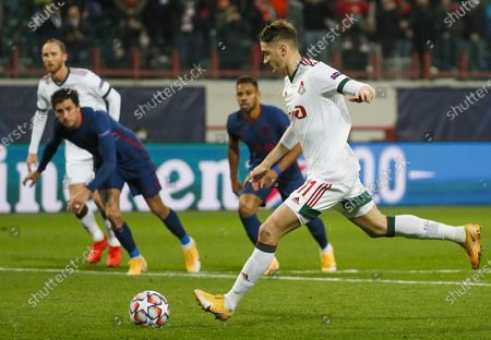 Anton Miranchuk of Lokomotiv Moscow scores the 1-1 from the penalty spot during the UEFA Champions League group A soccer match between Lokomotiv Moscow and Atletico Madrid in Moscow, Russia, 03 November 2020.