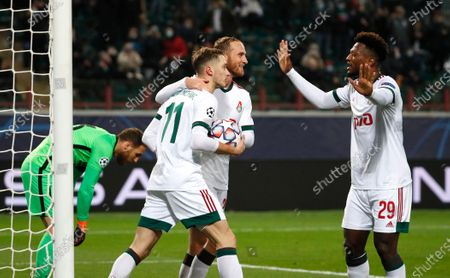 Lokomotiv's Anton Miranchuk, centre, celebrates with teammates after scoring his side's opening goal during the Champions League Group A soccer match between Lokomotiv Moscow and Atletico Madrid in Moscow, Russia