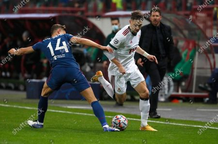 Atletico Madrid's Marcos Llorente, left, and Lokomotiv's Anton Miranchuk challenge for the ball during the Champions League Group A soccer match between Lokomotiv Moscow and Atletico Madrid in Moscow, Russia