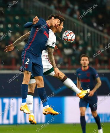 Stock Image of Atletico Madrid's Jose Gimenez, left, and Lokomotiv's Fyodor Smolov challenge for the ball during the Champions League Group A soccer match between Lokomotiv Moscow and Atletico Madrid in Moscow, Russia