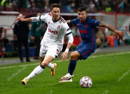 Lokomotiv's Anton Miranchuk, left, and Atletico Madrid's Angel Correa challenge for the ball during the Champions League Group A soccer match between Lokomotiv Moscow and Atletico Madrid in Moscow, Russia