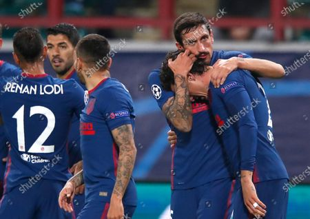 Atletico Madrid's Jose Gimenez, right, celebrates with Atletico Madrid's Stefan Savic after scoring his side's second goal during the Champions League Group A soccer match between Lokomotiv Moscow and Atletico Madrid in Moscow, Russia