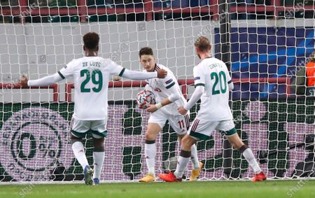 Lokomotiv's Anton Miranchuk, centre, celebrates after scoring his side's opening goal during the Champions League Group A soccer match between Lokomotiv Moscow and Atletico Madrid in Moscow, Russia