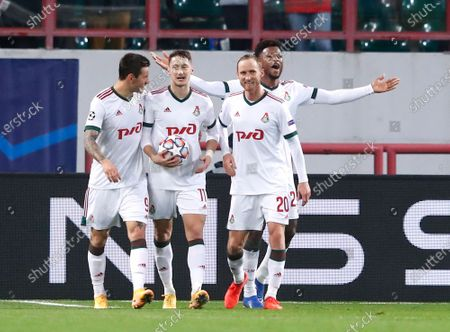 Lokomotiv's Anton Miranchuk, second left, celebrates after scoring his side's opening goal during the Champions League Group A soccer match between Lokomotiv Moscow and Atletico Madrid in Moscow, Russia